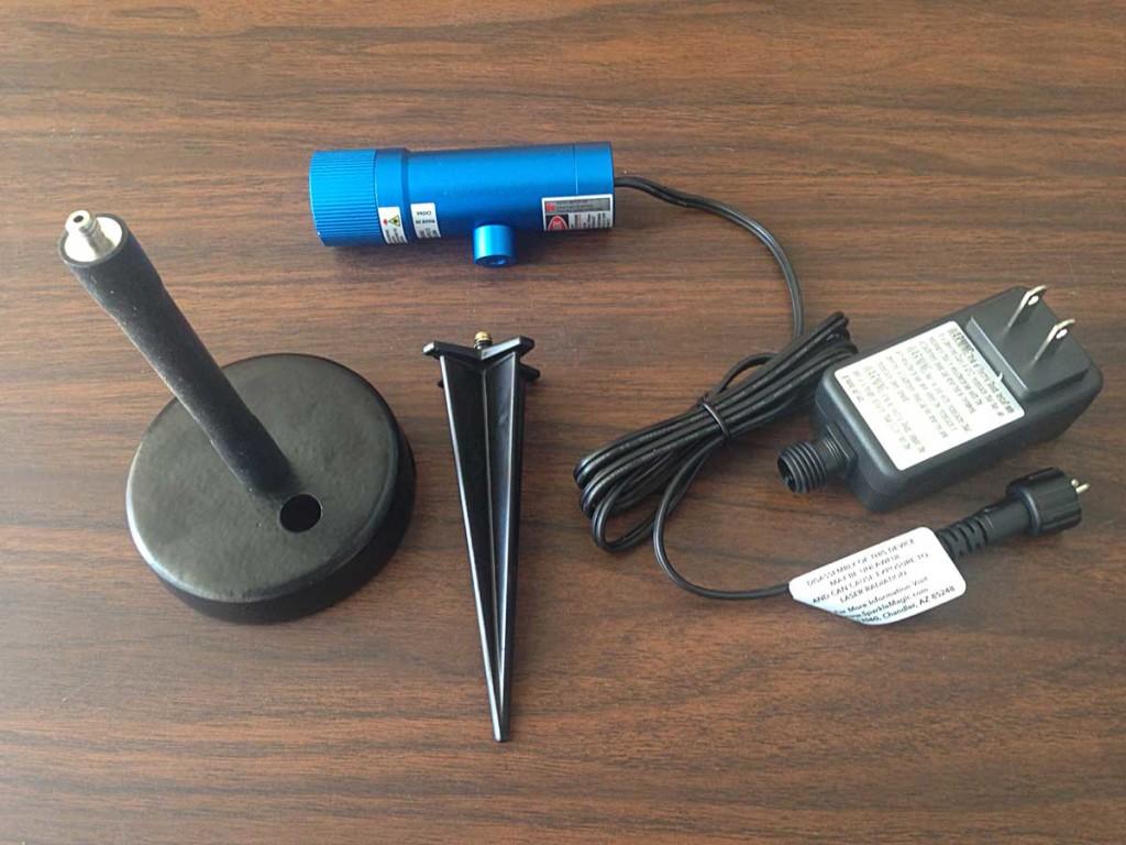 "1 Blue Illuminator Light, Flexible Stem, 5"" Ground Stake, Metal Base, Power Adapter."